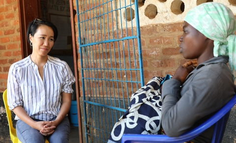 Won Young talks to a woman who had just given birth at Namitoso Camp in Machinga district