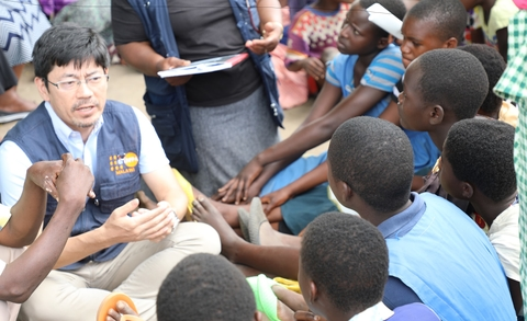 Masaki Watabe, UNFPA Deputy Representative engaging with adolescent girls before they received the dignity kits